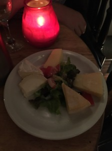 Cheese plate in Paris by candlelight.