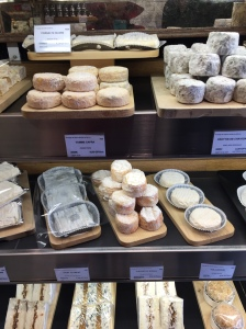 Selection of cheeses at fromagerie in Paris.