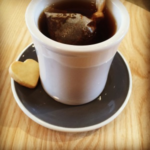 Hot black loose leaf tea with a wee delectable shortbread cookie on Valentine's Day.