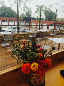 A rainy Sunday morning view of what is usually a sunny and bright patio.