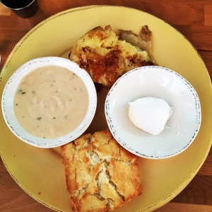 Biscuits, potatoes, and vegetarian herb gravy with fresh Cruze Farm butter.