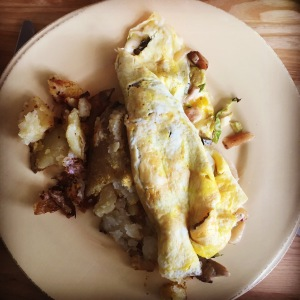 Olibea omelet with spicy pickled mushrooms and potatoes on the side. YUM.